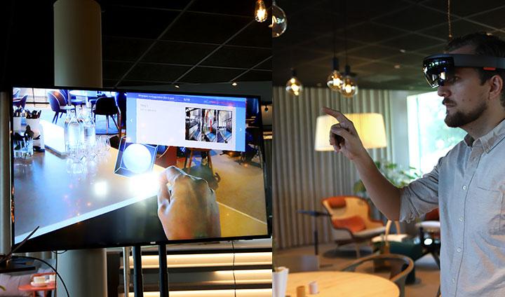 Anders Roos, systemutvecklare på Nethouse, ser en förstärkt verklighet genom ett par speciella glasögon. På skärmen i till vänster ser vi hur han upplever rummet och får virtuella instruktioner och uppgifter som han ska utföra.